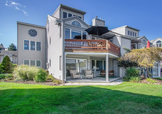 Comfortably Numb: Views of the Saugatuck Harbor cannot be beat from this beautiful 2 level condo with association swimming pool.