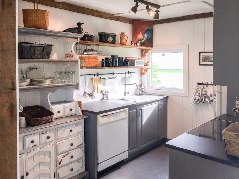 Bright, fully stocked kitchen with barn board accents. You'll love it it here.