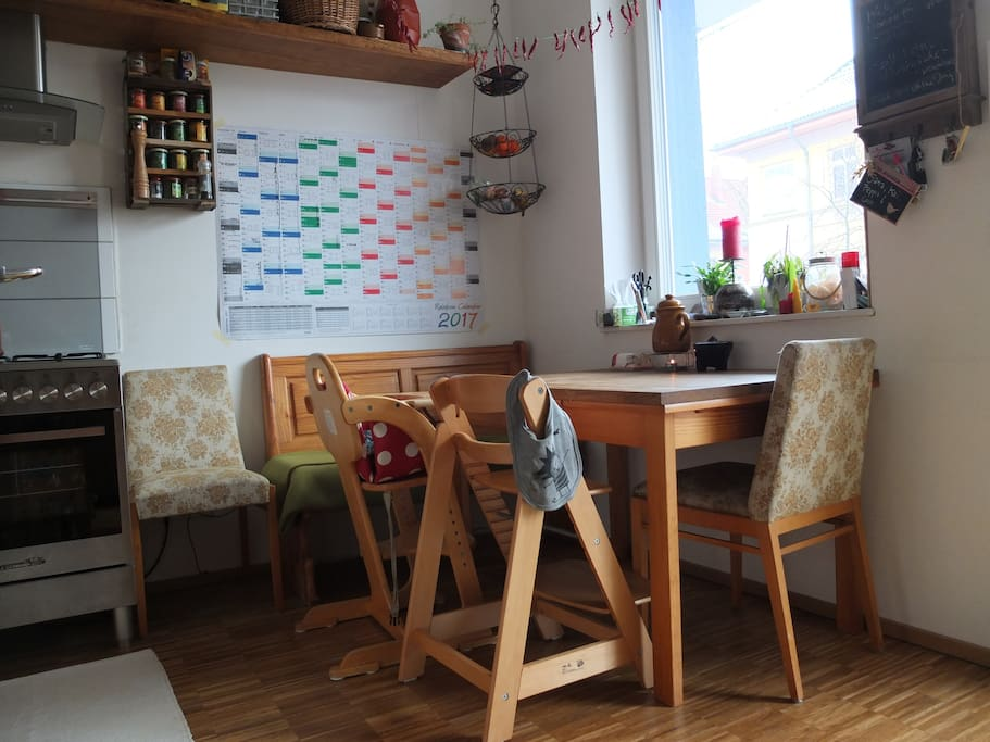 Kitchen table with two high chairs, bench and two chairs