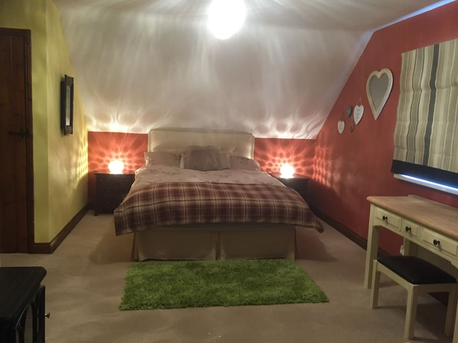 Large double bedroom, with en-suite bathroom and spacious shower. This picture showing luxurious Queen size bed at one end of the room.