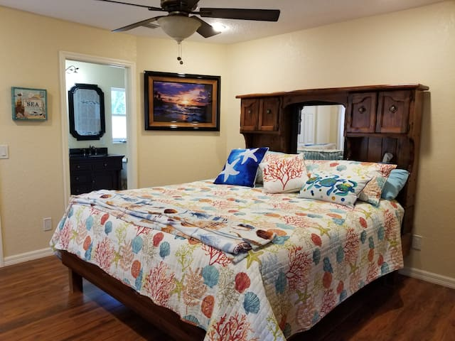 Master bedroom.  King size bed and ceiling fan.