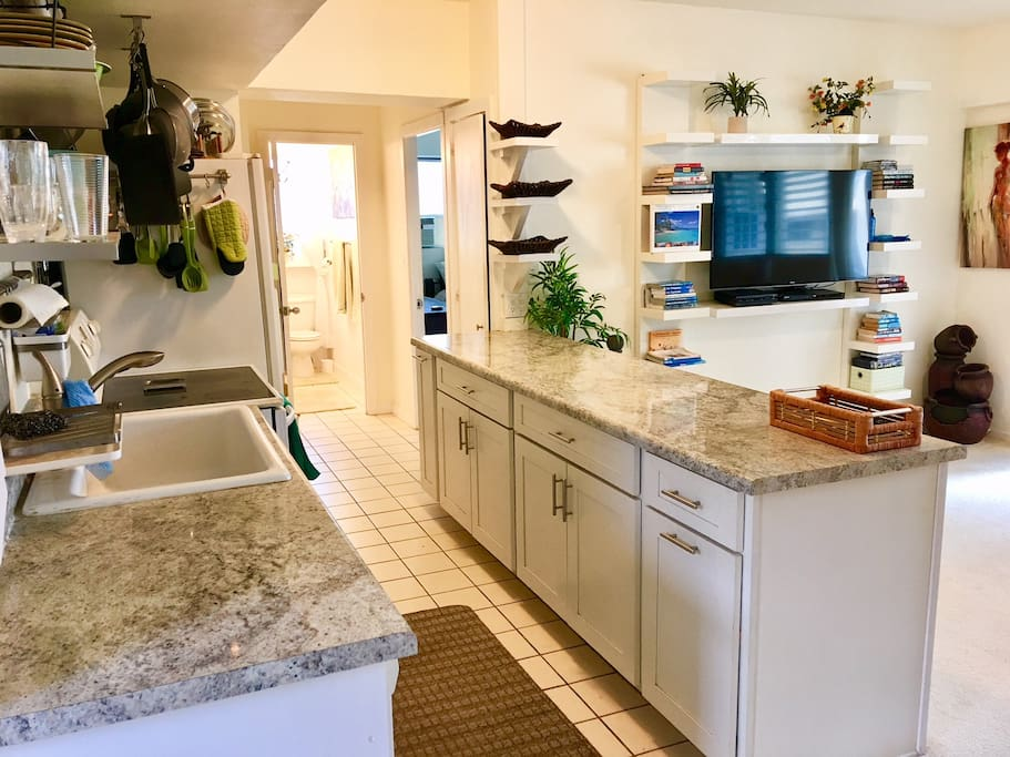 Spacious kitchen and 50 inch flat screen TV with DVD. TV can pull out and turn in any direction. Watch your favorite show while cooking!