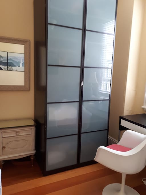 Large wardrobe with plenty of space for hanging clothes.