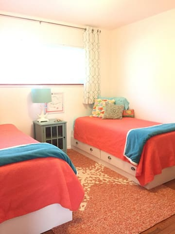 Colorful Crab Room with two twin Captains beds, topped with tempurpedic mattresses.