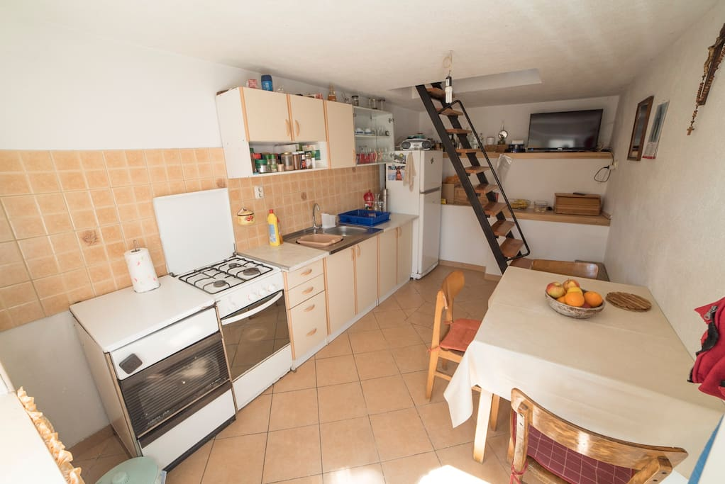 Kitchen with stove, gas refrigerator and LCD TV