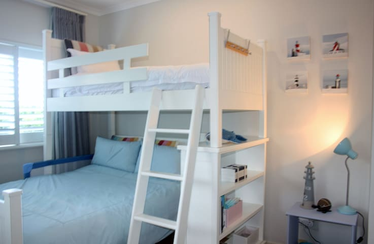 3rd Bedroom with bunk beds.  A Double mattress  and single size mattres on top level