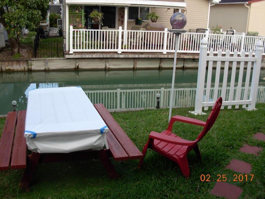 Picnic table in back yard on resaca