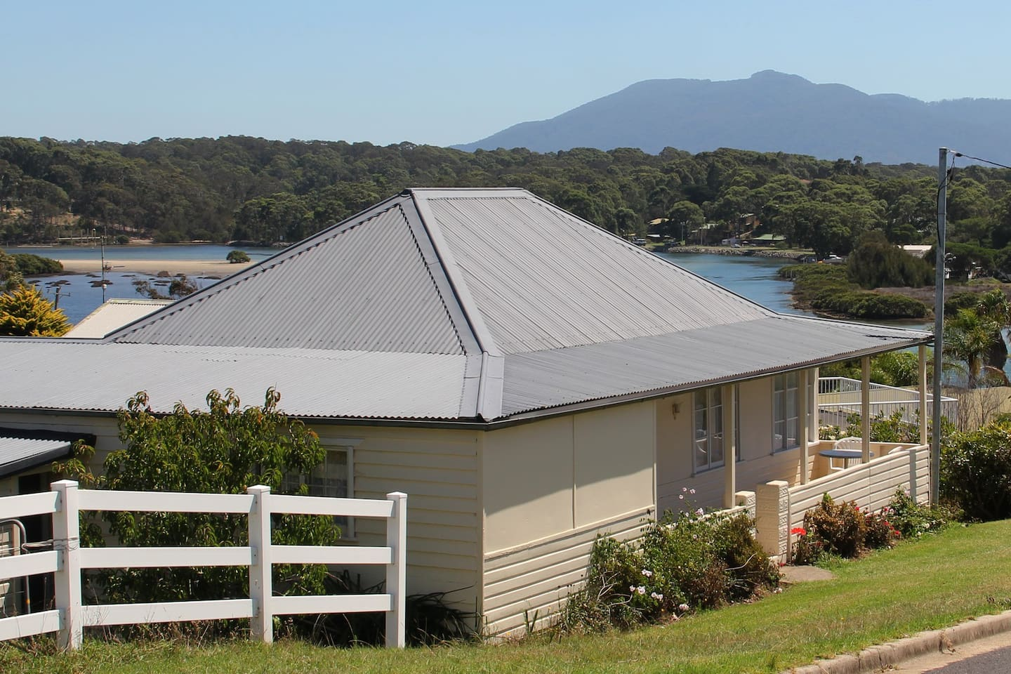 Gwandolan Cottage, with Bermagui river and Mt Gulaga (Mt Dromedary) in the background
