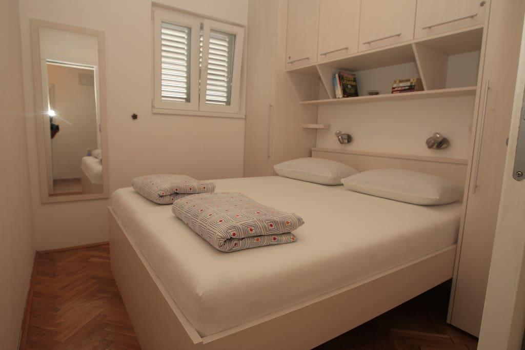 Bedroom 2/2 - double bed, small room but plenty of storage and ceiling fan for the warm nights