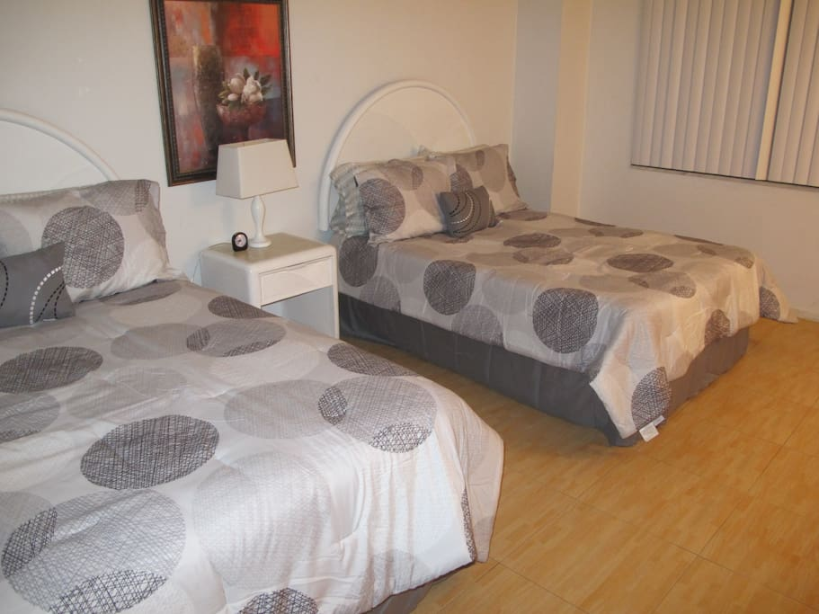 2 queen size beds with plenty of walking space