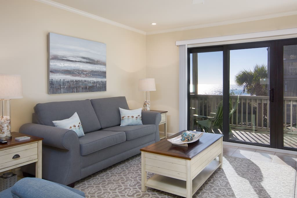 See The Beautiful Gulf Of Mexico Right From Your Floor to Ceiling Patio Doors in the Living Room, Leading Out to the Expansive Beach View Deck