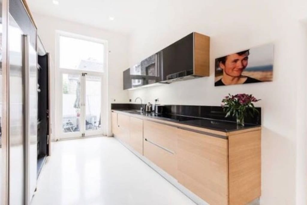 Fully equipped kitchen by Pedinni with all utensils open plan