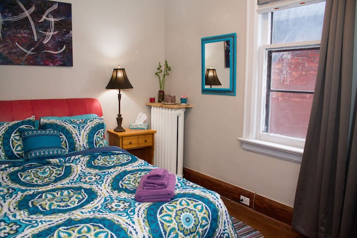 Colourful Artist's Downtown Bedroom