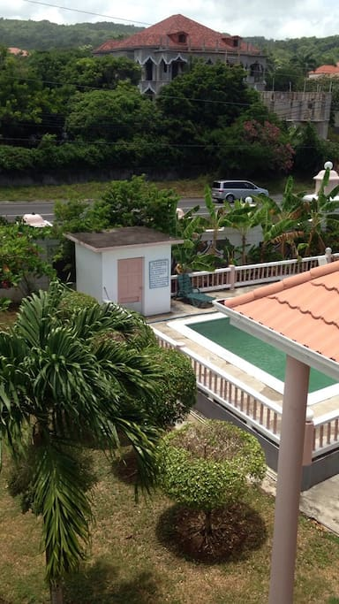 View from the balcony. Pool and view to main Road