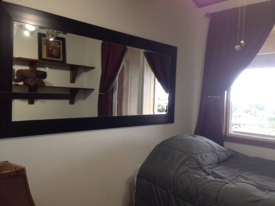 New large mirror on the wall really added a feel of spaciousness to this very cozy room