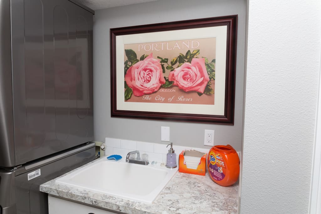 laundry room with double washer and dryer