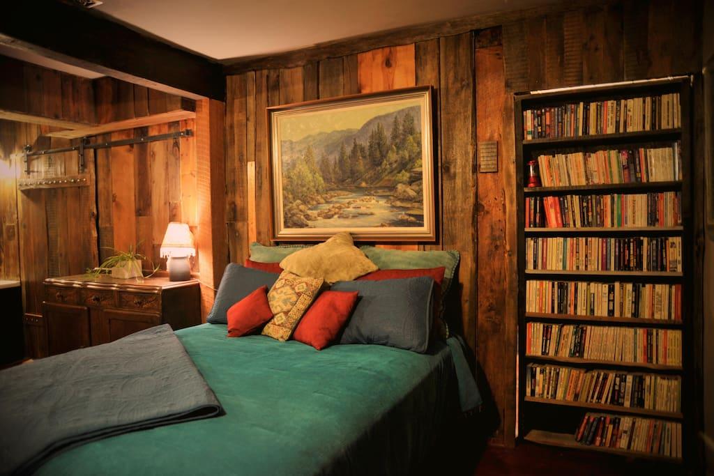 Bookcase opens as a hidden door to the Funky Bunkroom.