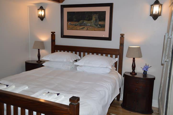 En-suite bedroom with queen-size bed