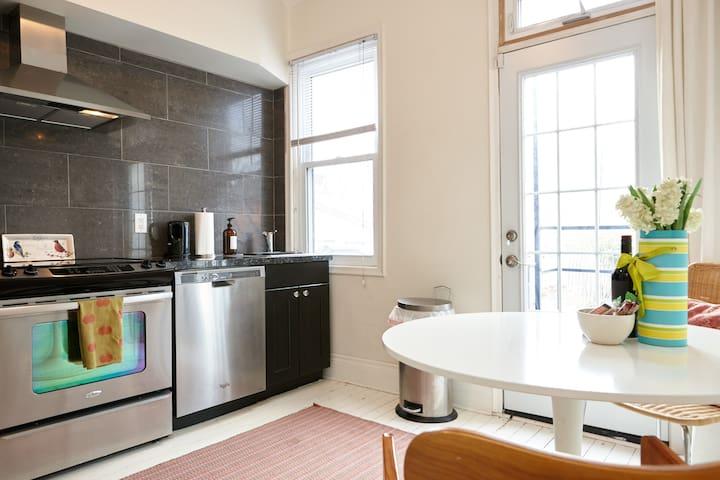bright kitchen with door to patio space in garden