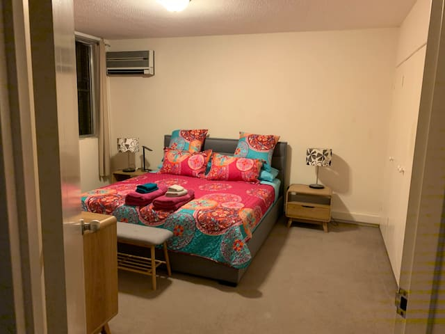 Bedroom 1: Master bedroom with king sized bed, built in wardrobes, dresser and occasional chair