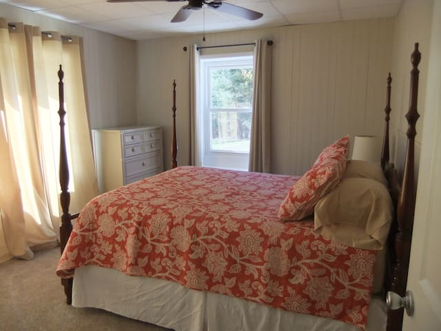 Bedroom #2 with queen bed and ceiling fan on lower level