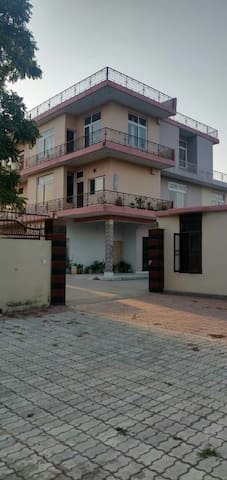 The property offered is part of Saini Guest Hoouse. In this listing a Suit is offered. This suit is in the 2nd floor of the House having Two Rooms. One is exclusive Bed Room of 14*14 having  attached Bath and living room and a small kitchen.