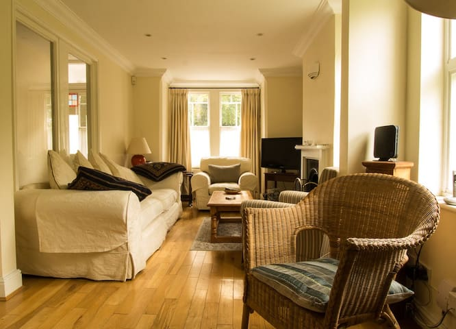 The living room is light and airy, comfortably furnished, and has TV and WiFi
