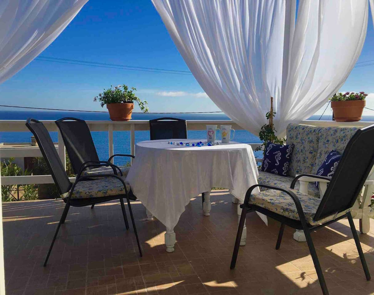 Enjoy the breathtaking view to the Mediterranean Sea drinking your coffee on the cozy porch