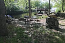 Lake access in the cove shows fire pit area