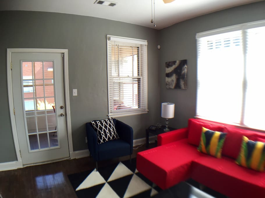 Living room, with door to screened porch