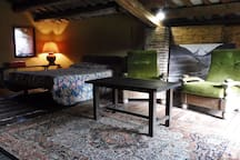 Your private room has a couple of armchairs in front of the wood-burning stove to chillout