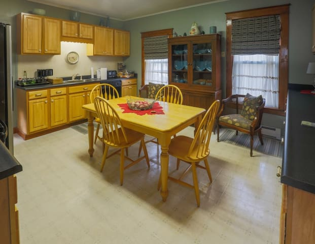 Kitchen is well stocked with  dishes, flatware, glasses, bakeware, pots and pans, etc.  Everything you need to prepare and serve meals.  Plenty of storage, small appliances include toaster, coffee maker, blender, mixer.