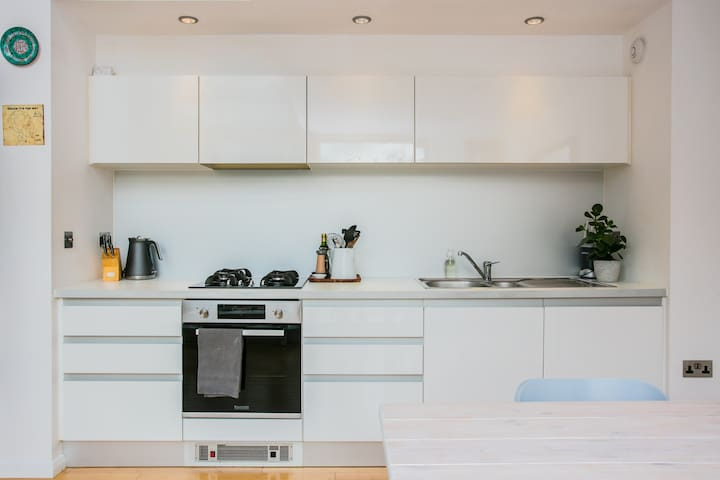 Modern kitchen with all the utensils and spices. (We love to cook here!)