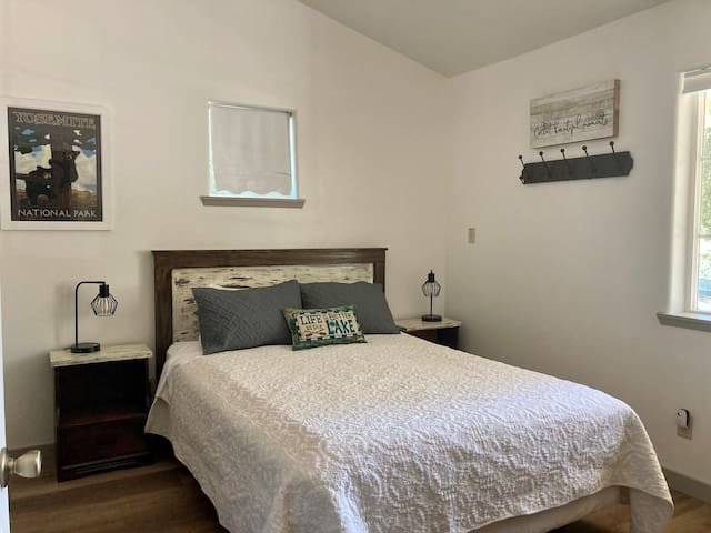Bedroom #2  Forest Bliss Room-is located next to the 1st floor Master Bedroom and has a roomy romantic feel. This room includes a Smart TV (NetFlix, Amazon, Etc).