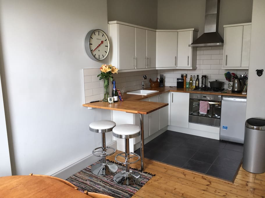 Bright airy kitchen..we normally don't venture far from the breakfast bar but if you feel the need their is a large kitchen table at the window too..