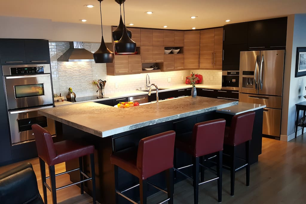 Chef's Kitchen with large island, two ovens and induction cooktop