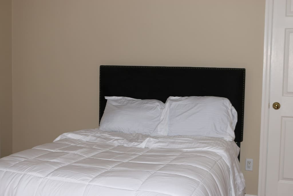 The full size bed is so comfortable. There are sheets, pillowcases, and a comforter on the bed.