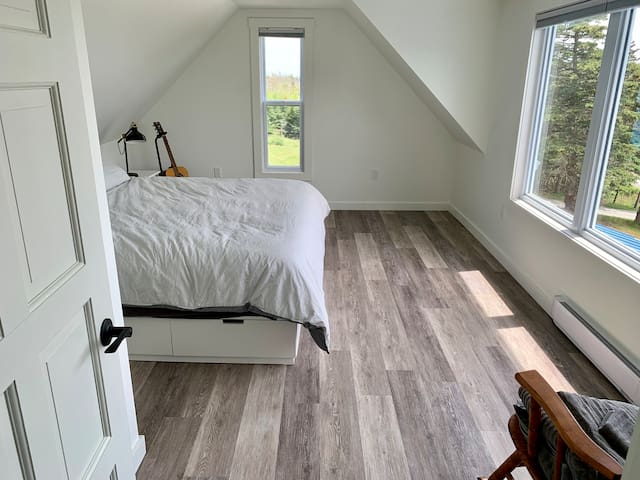 Master bedroom with king bed and fantastic view.