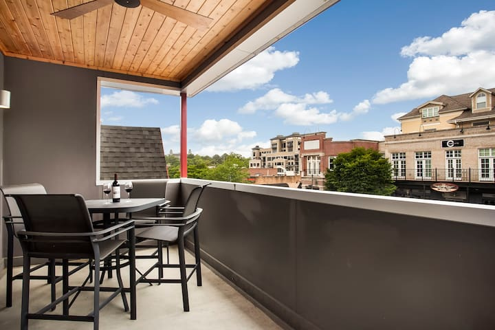 Step outside & enjoy the perfect perspective of Dickson Street and the historic University of Arkansas Old Main in the distance! Your own private patio is covered and seats four.