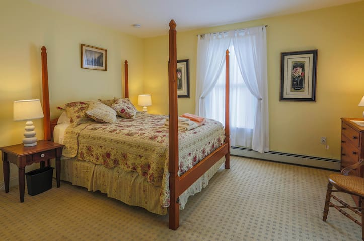 Queen size, Four Poster Bed graces the master bedroom