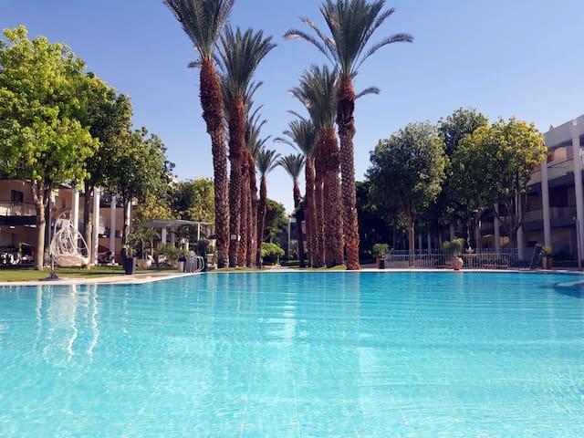 Royal Park- Garden condo by the pool