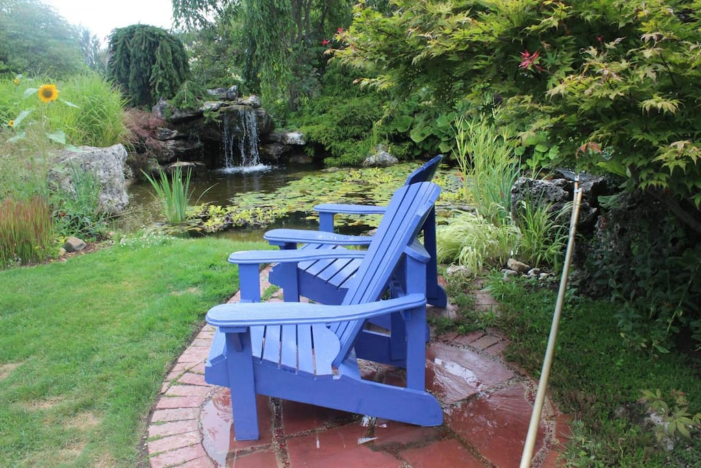 Waterfall at pond in garden with sitting area