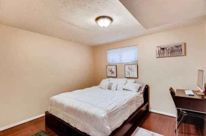 The second room has a queen bed with a super comfy mattress topper and a desk for a laptop. Have a goodnight sleep in a comfortable bed with a large closet for storage.