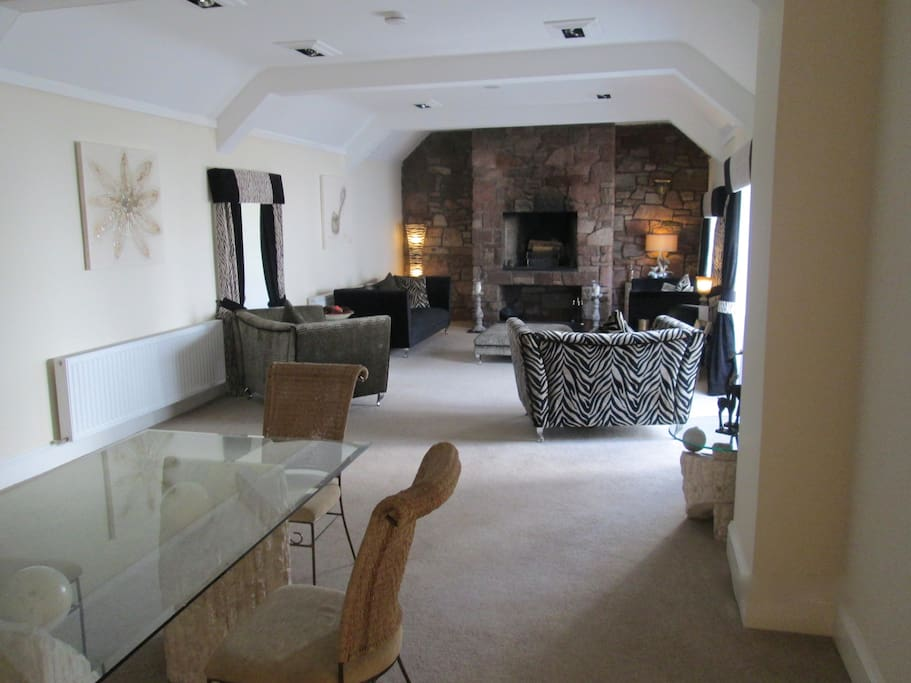 Large formal lounge with feature stone fireplace