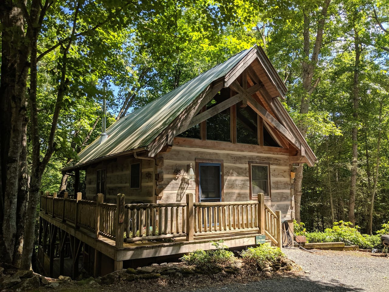 Wrap around porch, to back side of cabin.
