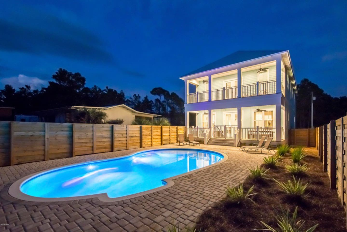 Beautiful lit pool heated in the winter months with lower deck and upper deck off master suite.