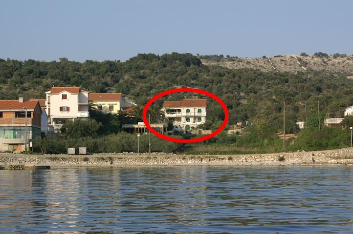 Two bedroom apartment with balcony and sea view Jakišnica, Pag (A-4054-b)