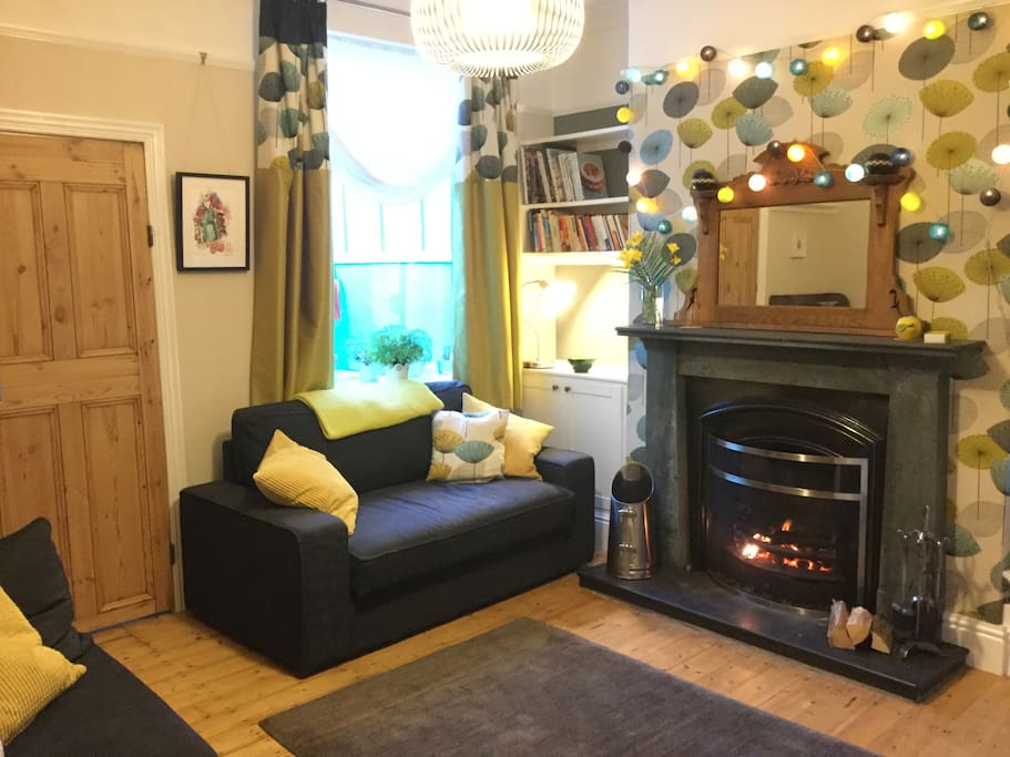 Homely real fire (fuel provided). Sofa converts to an extra double bed.
