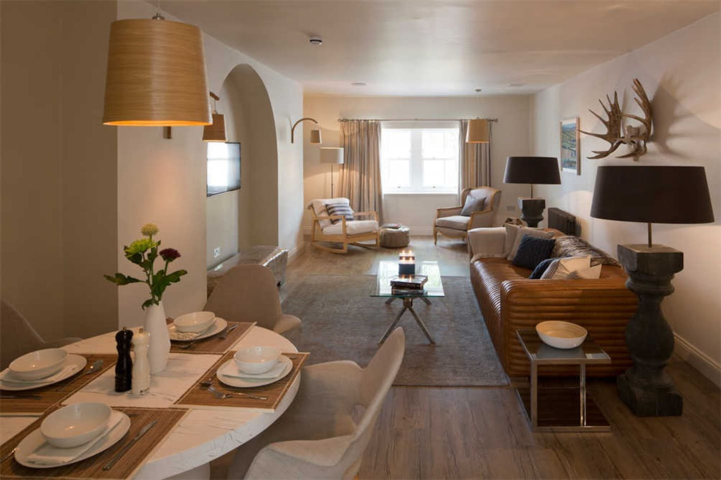 A light, modern living space complete with digital TV and Sonos music system.