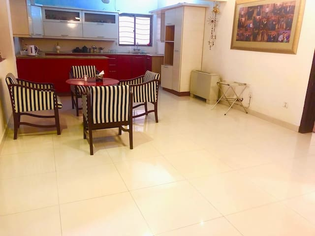 American kitchen for comfortable cooking and a dining table for the family